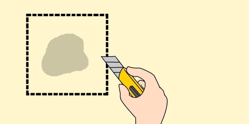 ①穴の周りをカッターで四角く切り既存の壁紙を剥がす。