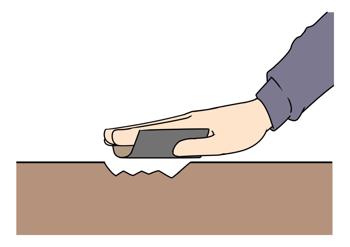 ②剥がれの周辺を広く浅く80番あたりのサンドペーパーで優しく削り、削った粉を集める。